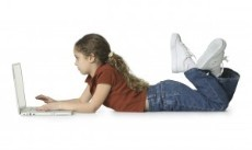 GIRL-ON-STOMACH-COMPUTER-300x179.jpg